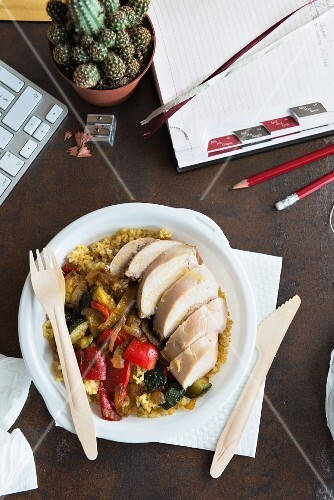 Chicken breast with bulgur wheat and vegetables in an office