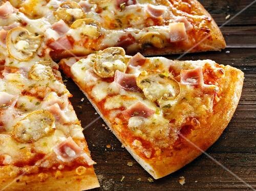 Ham and mushroom pizza, sliced