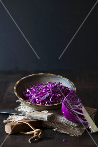 Freshly sliced red cabbage in a wooden bowl