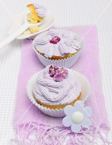 Cupcake decorated with purple buttercream and sugared violets