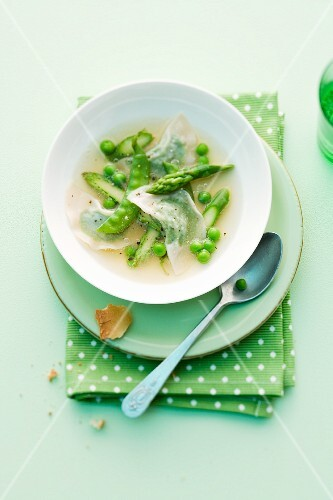 Vegetable stock with pea wontons and green asparagus