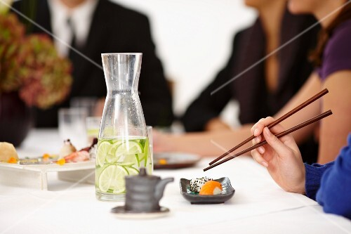People eating sushi in a restaurant