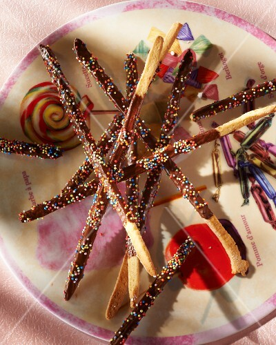 Chocolate sticks decorated with coloured sprinkles