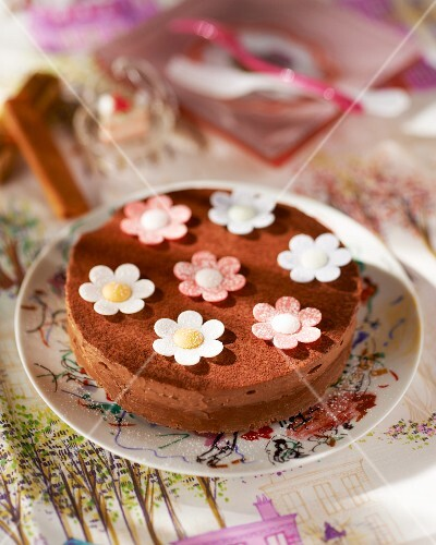 A chocolate cake decorated with fondant flowers