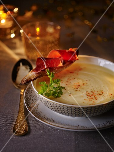 Cream of parsnip soup with cured ham for Christmas dinner