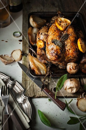 Roast chicken with sage, lemons, onions and garlic
