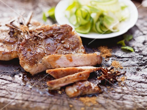 Caramelised pork cheeks on a cucumber and ginger salad