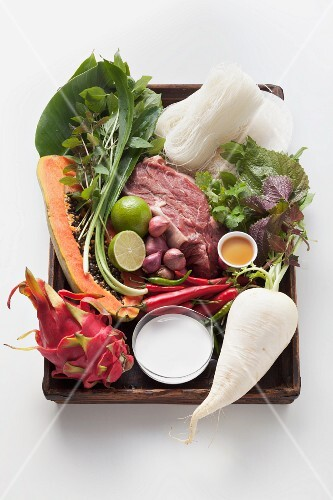 Various ingredients for Vietnamese dishes on a wooden tray