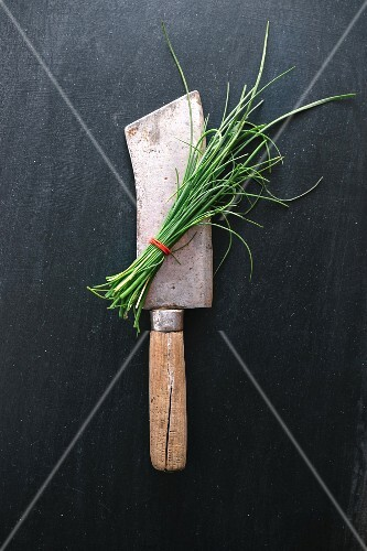 Chives on a vintage meat cleaver