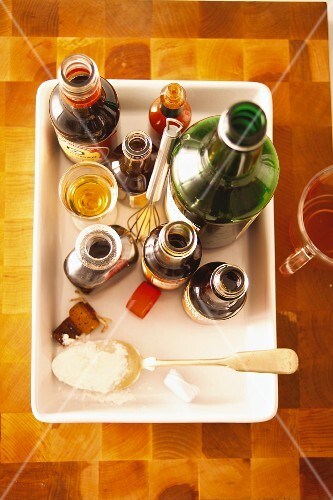 Various spicy sauces and a bottle of wine