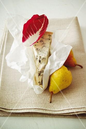Gorgonzola, pears and a radicchio leaf on a linen cloth