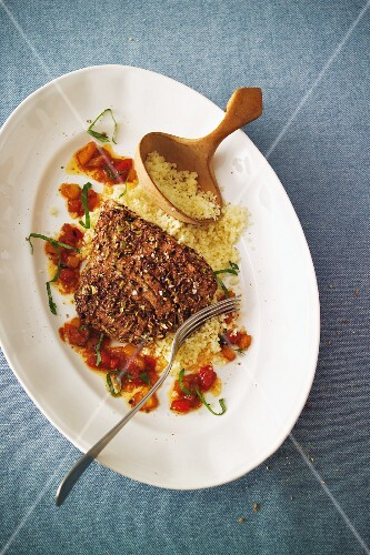 Tuna escalope in a spicy coating with harissa sauce
