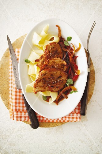 Veal escalope in a spicy pepper sauce served with tagliatelle
