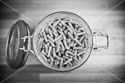 A bird's-eye view of a jar of organic durum wheat pasta (black-and-white image)