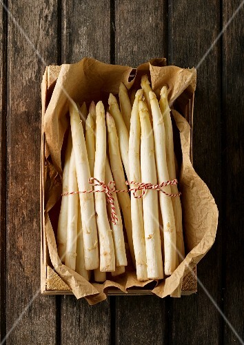 Bunches of fresh white asparagus in a crate