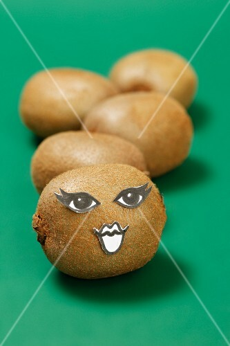 A kiwi with a face