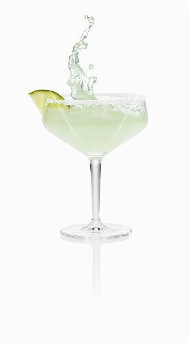 A Margarita splashing out of a glass