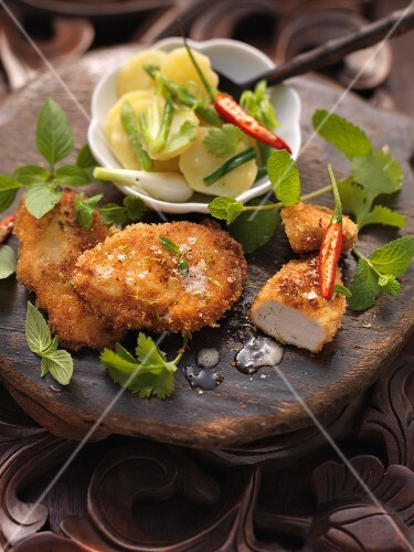 Bavarian fried chicken on a Thai potato salad