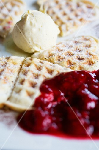 Waffles with vanilla ice cream and raspberry jam