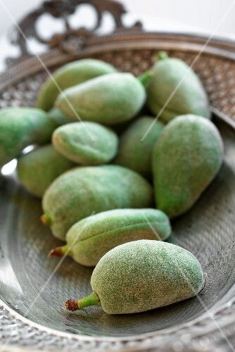 Green almonds in a silver dish