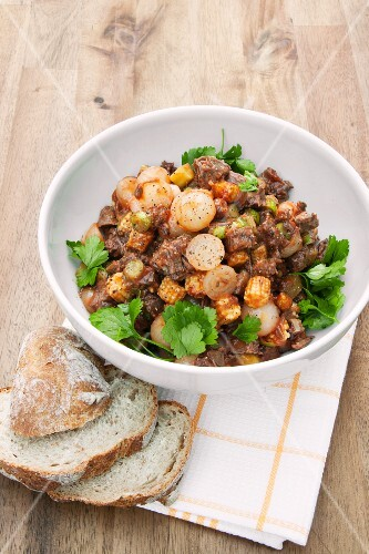 Spicy beef salad with baby corn cobs