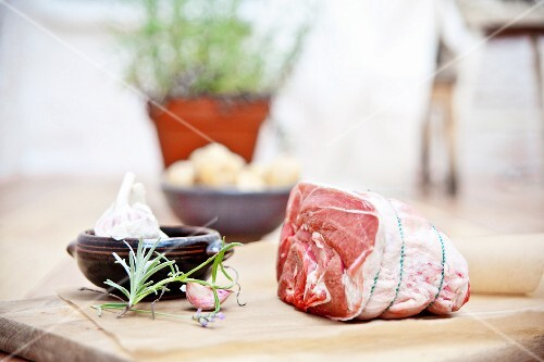 Rolled shoulder of lamb with rosemary, garlic and new potatoes