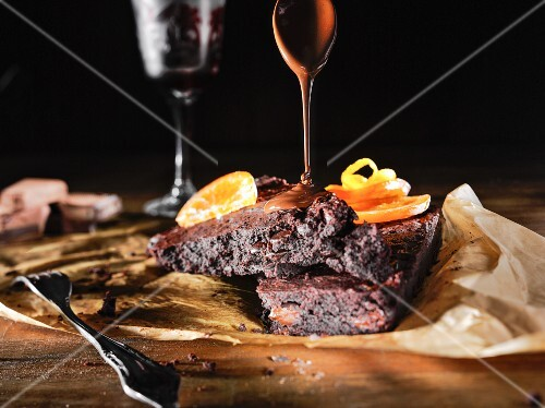 Brownies with chocolate sauce and orange slices