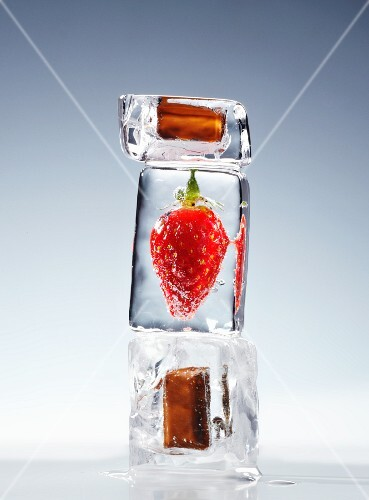 Strawberries and chocolate in ice cubes