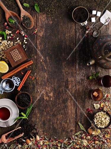 Various types of tea arranged around the edge of the picture
