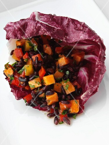 Vegetable rice in a radicchio leaf