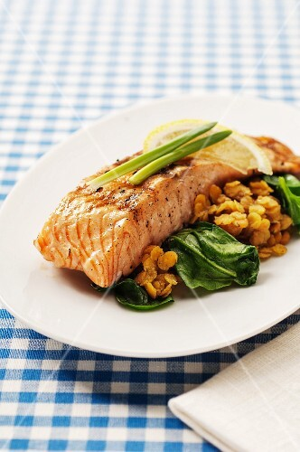 Fried salmon steak on a lentil medley