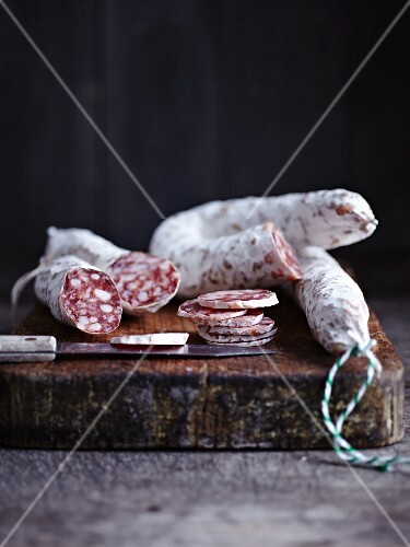 Salami, sliced, on a chopping board