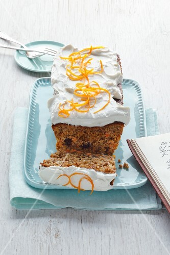 Carrot cake with white frosting and orange zest