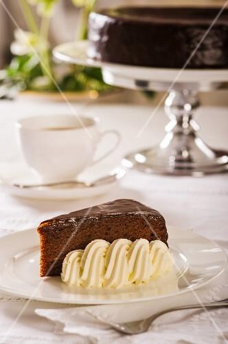 Sachertorte (rich Austrian chocolate cake) with whipped cream