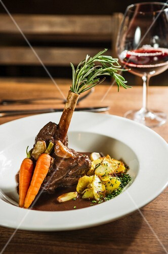 Leg of venison with roast potatoes and carrots