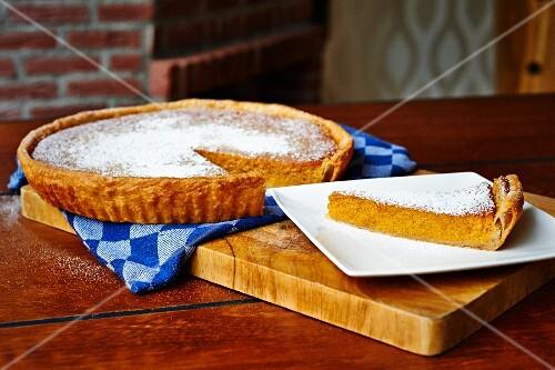 Potato and sweetcorn tart with icing sugar