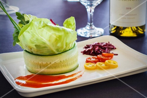 A fresh garden salad served in a cucumber roll