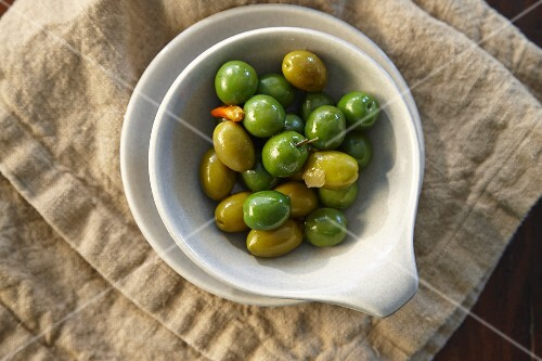 Green olives and capers in a dish