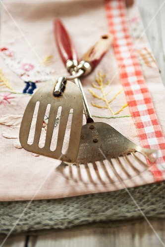 Two spatulas on a country-style tea towel