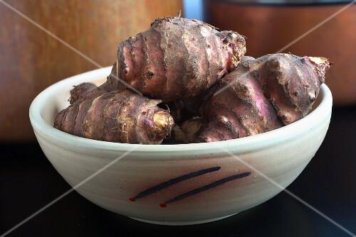 Jerusalem artichcokes in a ceramic bowl