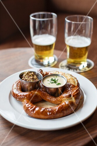 A lye bread pretzel with whole grain mustard and Amish Cheddar and ale sauce