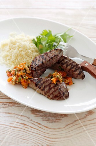 Grilled duck breast with apricot sauce and rice