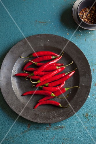 Fresh red chilli peppers on a plate