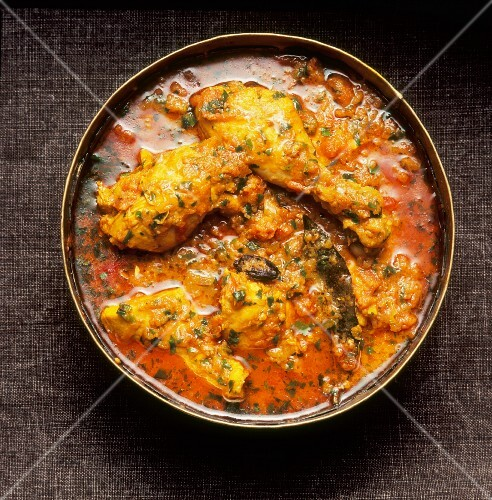 Chicken curry with herbs (seen from above)