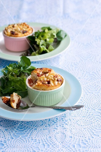 Mini cheese quiches with pine nuts and water cress