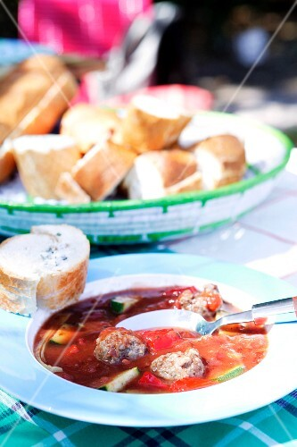 Tomato soup with chicken meatballs and baguette