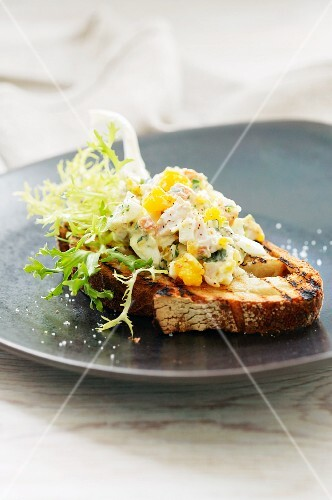 Grilled bread topped with egg salad
