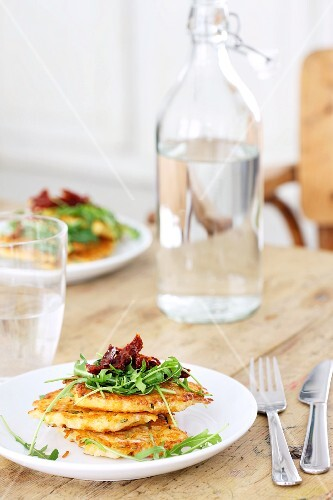 Potato cakes with rocket and dried tomatoes