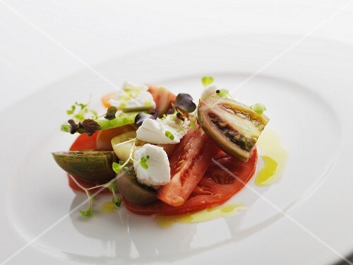 Tomato salad with cress, olive oil and mozzarella