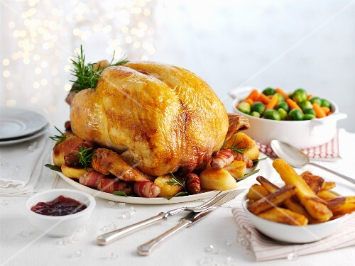 Traditional roast turkey with roast potatoes, carrots and sprouts (Christmas)